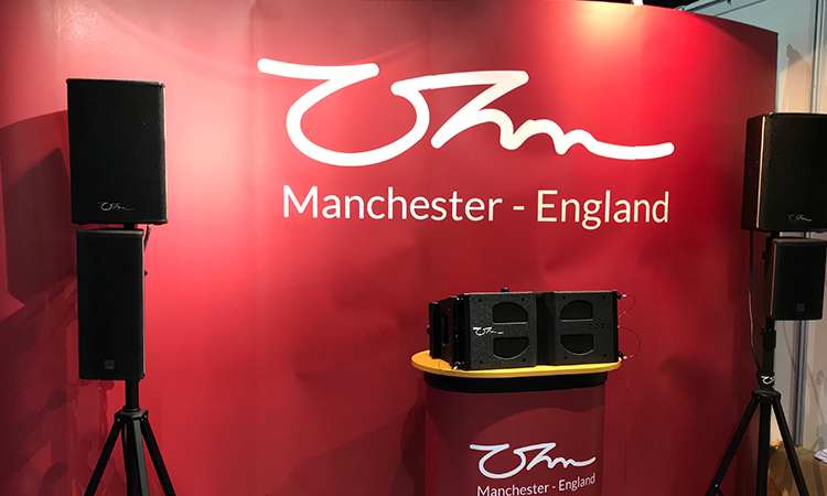 Ohm speakers on display for show visitors.