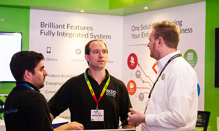Chatting rental software with visitors to the stand.